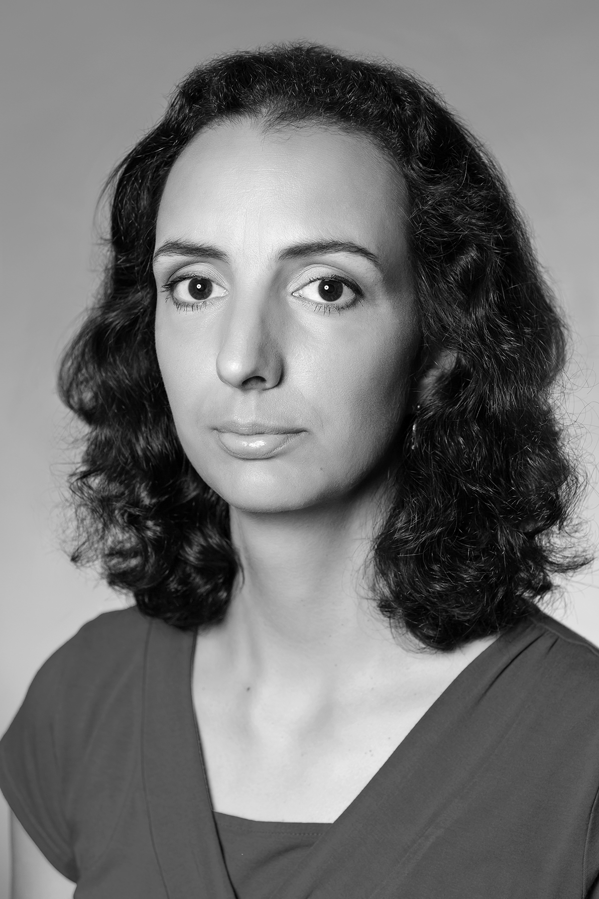 PhDr. Dita Tesárková, Associate  Director