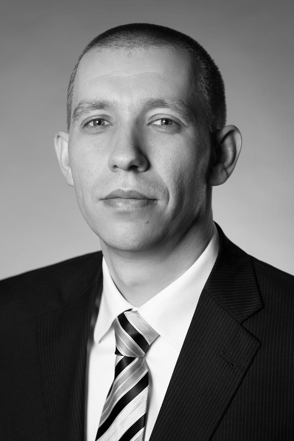 Mgr. Ján Slavíček, Associate  Director
